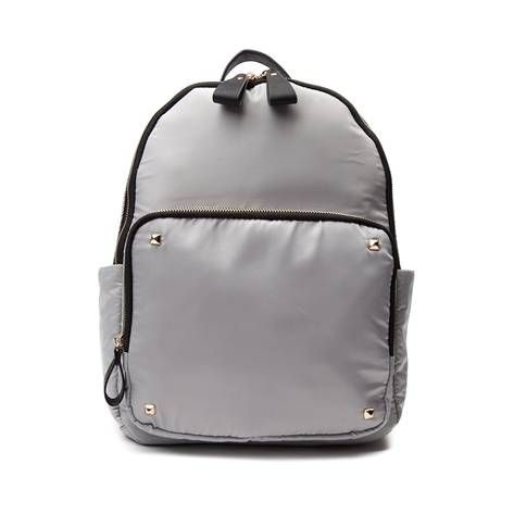 School your friends in style with the awesome new One Pocket Backpack! Dive into your day with the chic style of the One Pocket Backpack, featuring a sturdy nylon exterior with front organizer pocket, embellished with gold-tone hardware and pyramid stud details.
