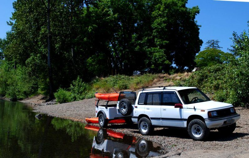 Down By The River With A Dinoot Setup As Kayak Trailer
