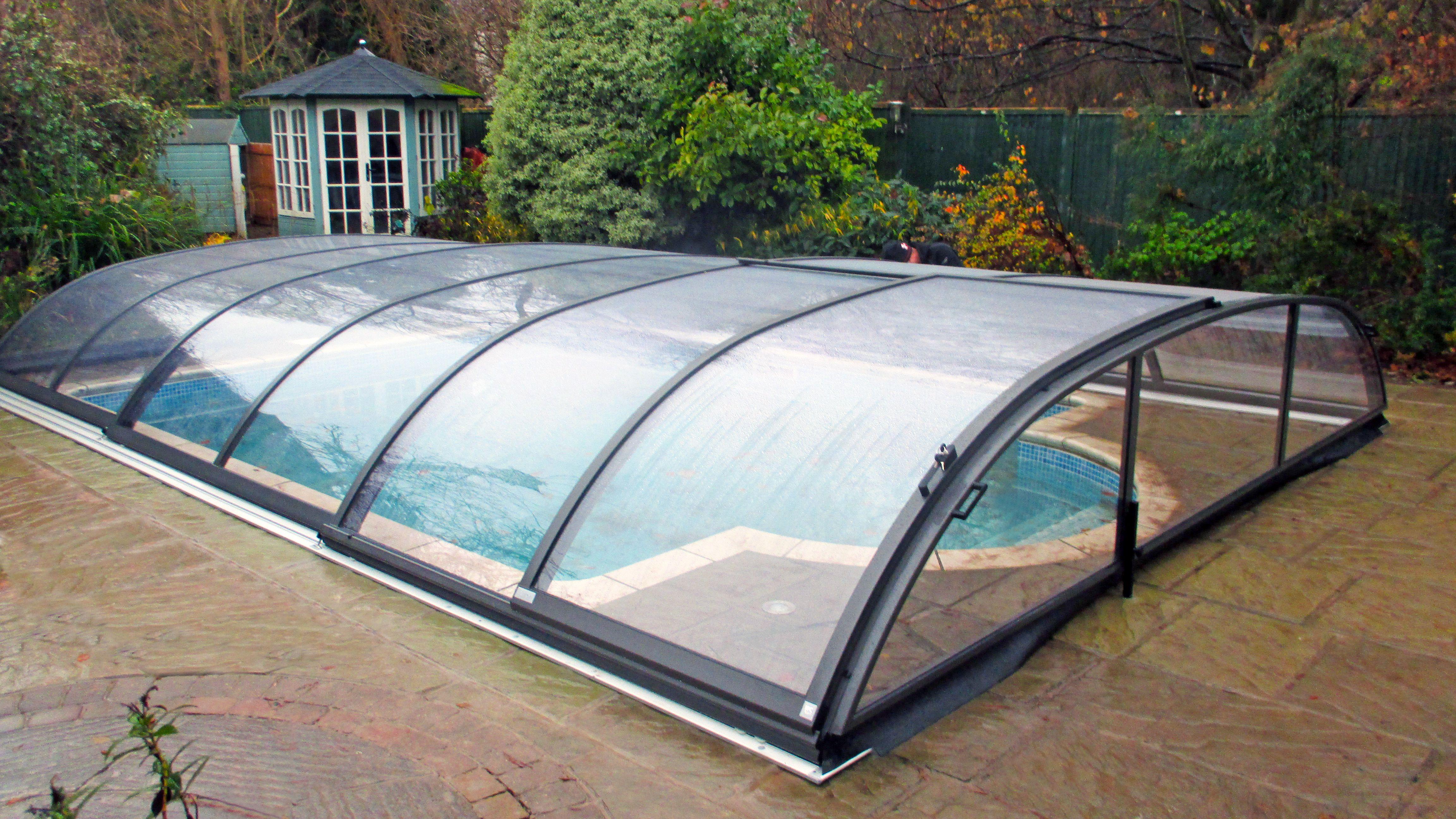 Elegant low level swimming pool enclosure swimming pool