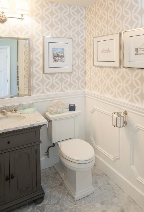 Chic powder room features top half of walls clad in beige ...