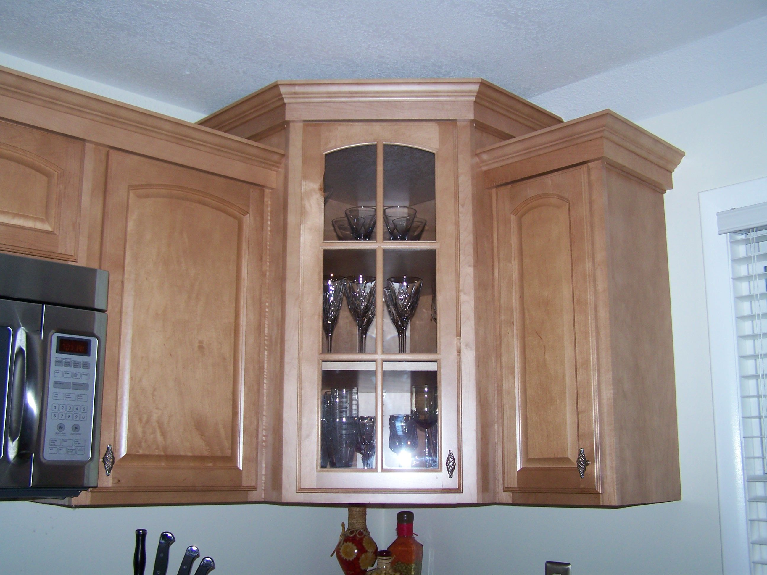 Kitchen corner cabinet with glass door