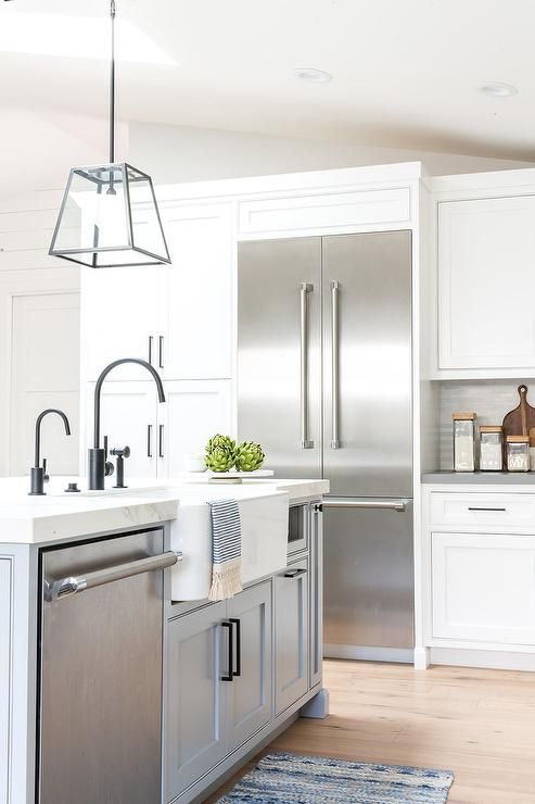 Recessed Beside Stacked White Cabinets Accented With Oil Rubbed Bronze Hardware A Stainless White Kitchen Renovation Industrial Kitchen Design Kitchen Design