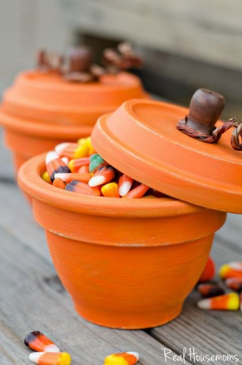 Adorable pumpkin pots make great party favors. Just paint terracotta pots and fill with candy corn!
