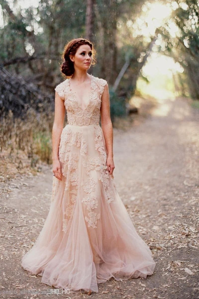 4bfe814b83fc It's a trend that's been around for a while, but we just can't get over it.  A pale blush, blue, or grey gown is timeless but still ultra-unique.