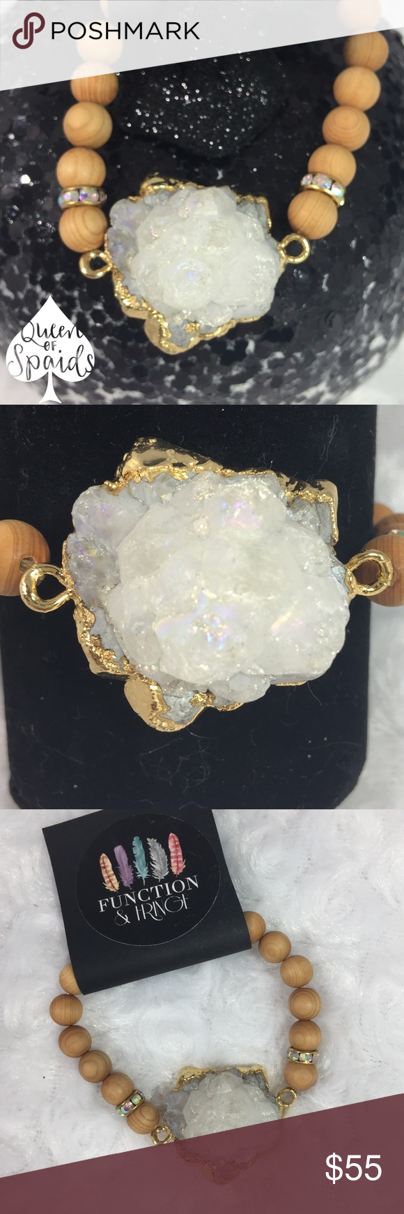 Rainbow Solar Quartz Bracelet - Style 2 This is a one-of-a-kind white Rainbow Solar Quartz Bracelet. The pendant is gold-plated and surrounded by amazingly fragrant Sandalwood beads, rhinestone spacers, and a gold-plated bead. I have a few of these, but d
