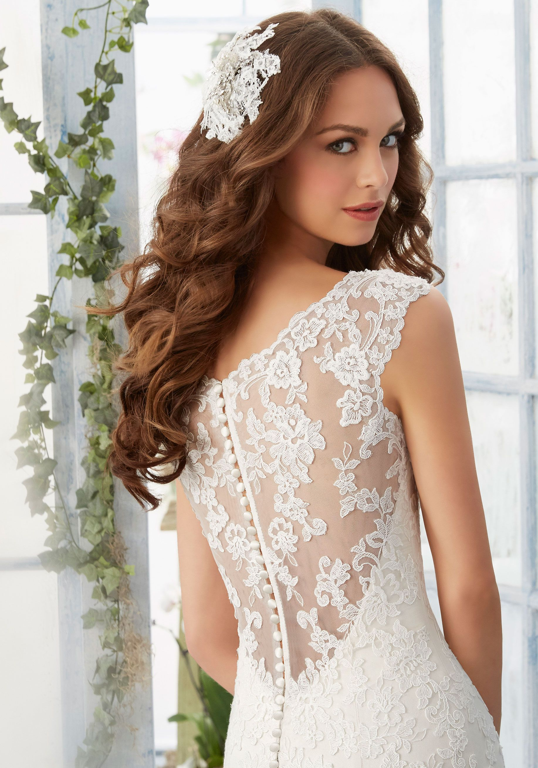 Color embroidered wedding dress  Soft smooth this satin wedding dress is accented with highly