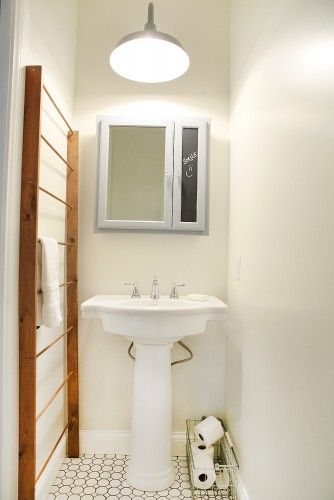 Towel Rack Of Dowels And 2x4 Uprights For A Tiny Bathroom