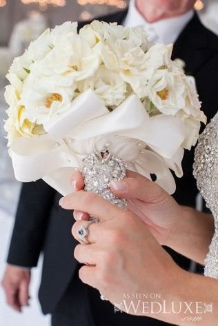 Beautiful off-white bouquet personalized with the bride's lace and a photo. Flower design Frank Rea Forget Me Not Flowers Anne Anderson Events