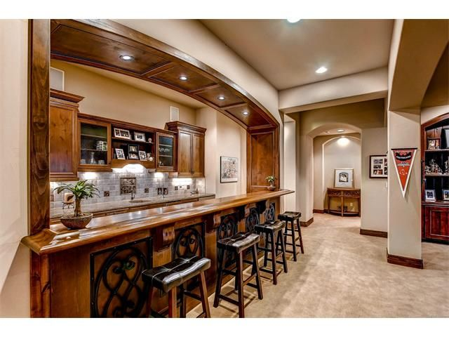 Walk Out Basement With Its Beautiful Cherry And Alder Wet Bar, Stone And  Alder