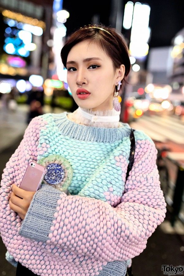 "Dec 2013: Kokoru Kin's look includes a colorful sweater from the H&M x Minju Kim collection with an embellished miniskirt, graphic tights, and One Spo furry winged platforms. Accessories include a ""Queen"" tiara, pastel earrings, a lace choker, several cute badges, and a Vivienne Westwood heart handbag with space print."