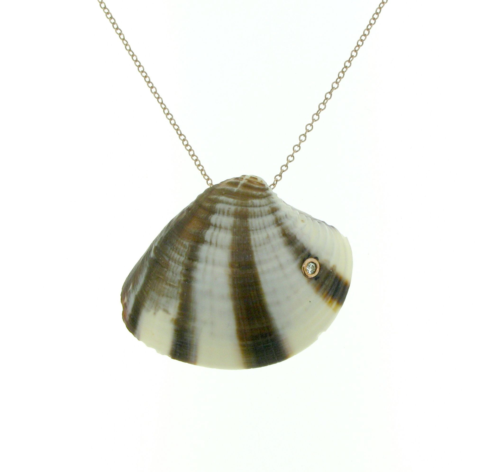 Sigal Gerber Jewelry shell necklace has a diamond set in 18k rose gold with a cultured pearl on the back of the shell, and a white gold chain. www.sigalgerber.com