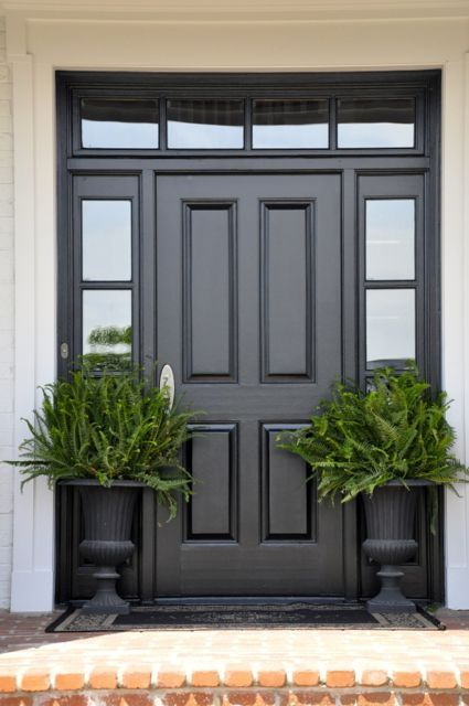 Traditional black and white entry with excellent potted ferns in urns - World Best #Diy Blogs