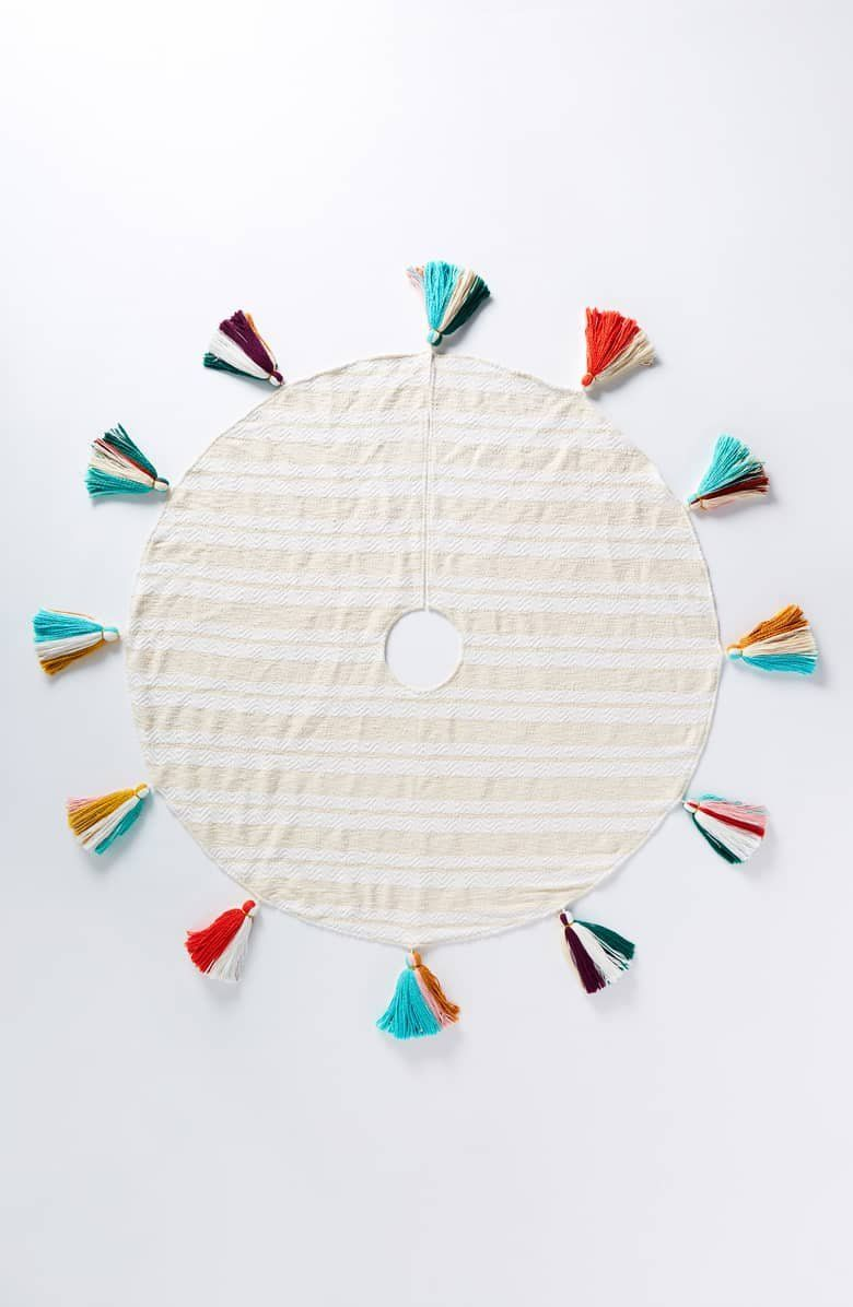 Add playful swing to your holiday décor with a creamy cotton tree