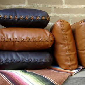 Hand-Laced Leather Pillows by rick badgley