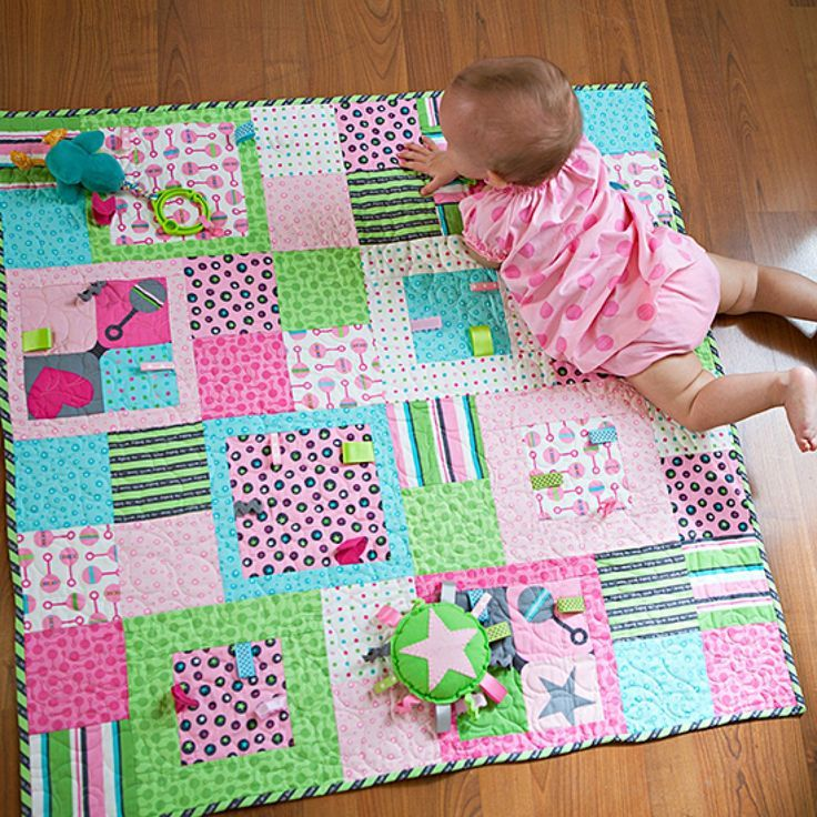 Add fun and fuction to a stroller-size quilt by sewing ribbon and ... : childrens patchwork quilt - Adamdwight.com
