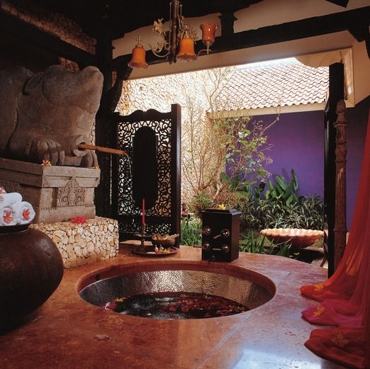 Take a bath: The unique yet romantic bathroom at Tugu Hotel Malang's Apsara Suite. http://tuguhotels.com/malang/