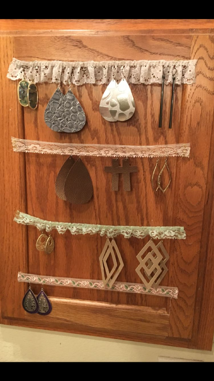 Vintage lace and hot glue on medicine door