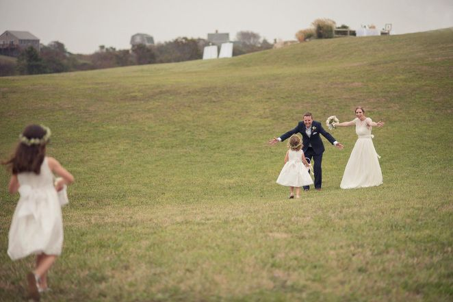 Hugs from the Flowergirls Post Ceremony at a Rose Farm Inn Block Island Wedding ©Snap Weddings
