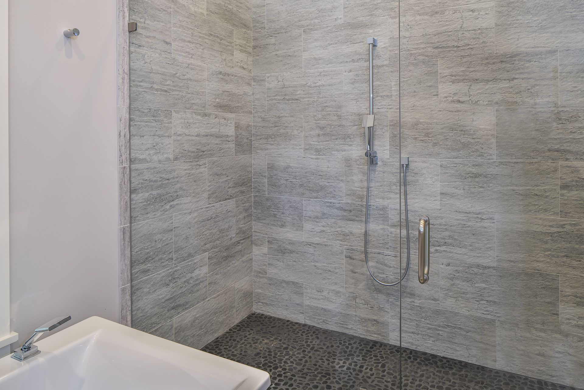 This Wow Master Bath Has A Striking 12 X 24 Porcelain Tile With Wood Grain Texture Floor And A Pebble Ston Porcelain Countertops Flooring Bathroom Renovation