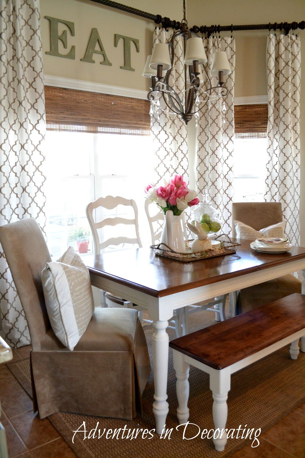 Bay window, farmhouse table, bench, and different chairs