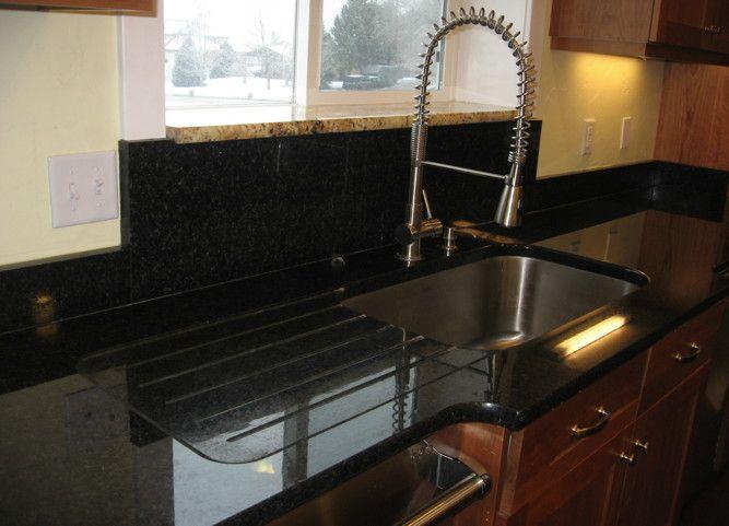 Kitchen sink granite drainboard kitchen pinterest for Integrated quartz sink