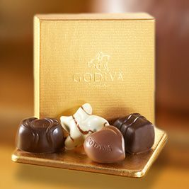 Gold Ballotin - When the occasion calls for a token of thanks our new 4 pc. Gold Ballotin is a perfect gift for lovers of fine chocolate indulgences. Contains a quartet of assorted chocolates, including Milk Praline Heart, Dark Ganache Bliss, Raspberry Star and Dark Caramel Embrace.