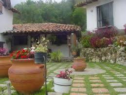 Decoracion con jarrones de barro buscar con google - Jarrones decorativos para jardin ...