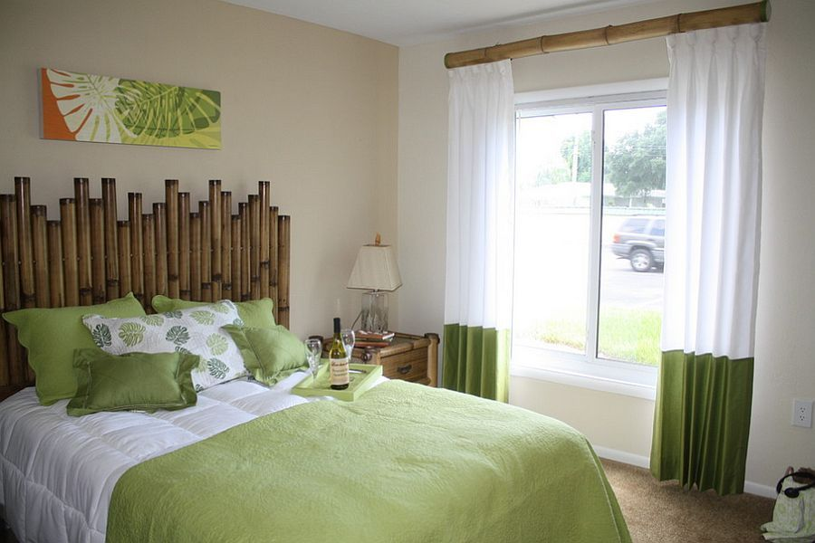 bamboo headboard with a matching curtain rod and beside table for