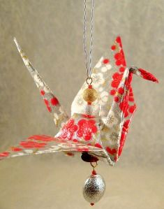Origami Cranes, maybe some will be given to family, and then can make this or a mobile