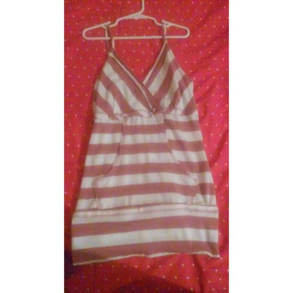Striped tank top There is a pocket in the front of this tank top and it is super comfy. Younique Tops Tank Tops