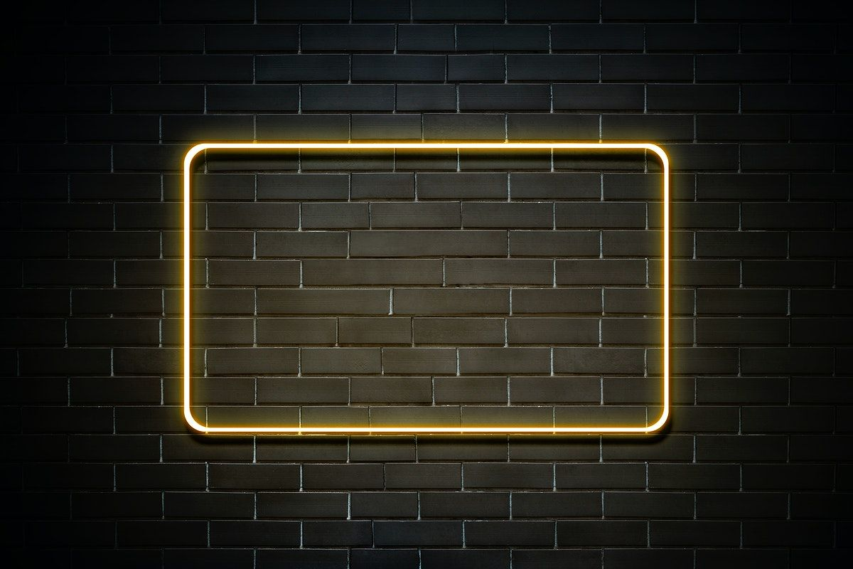 Download premium psd of Neon red frame on a brick wall