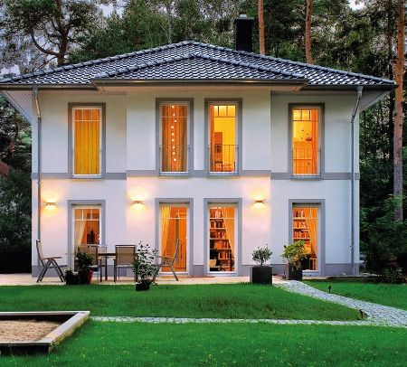 Stadtvilla mit erker  Mediterrane moderne Stadtvilla bauen - mit Garage und Klinker ...