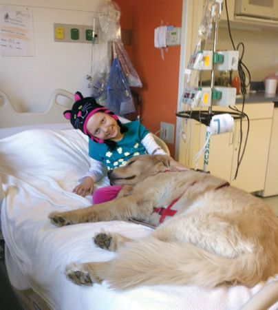 Mercede Carmichael bonded with therapy dog Gov at Presbyterian Hemby Children's Hospital.