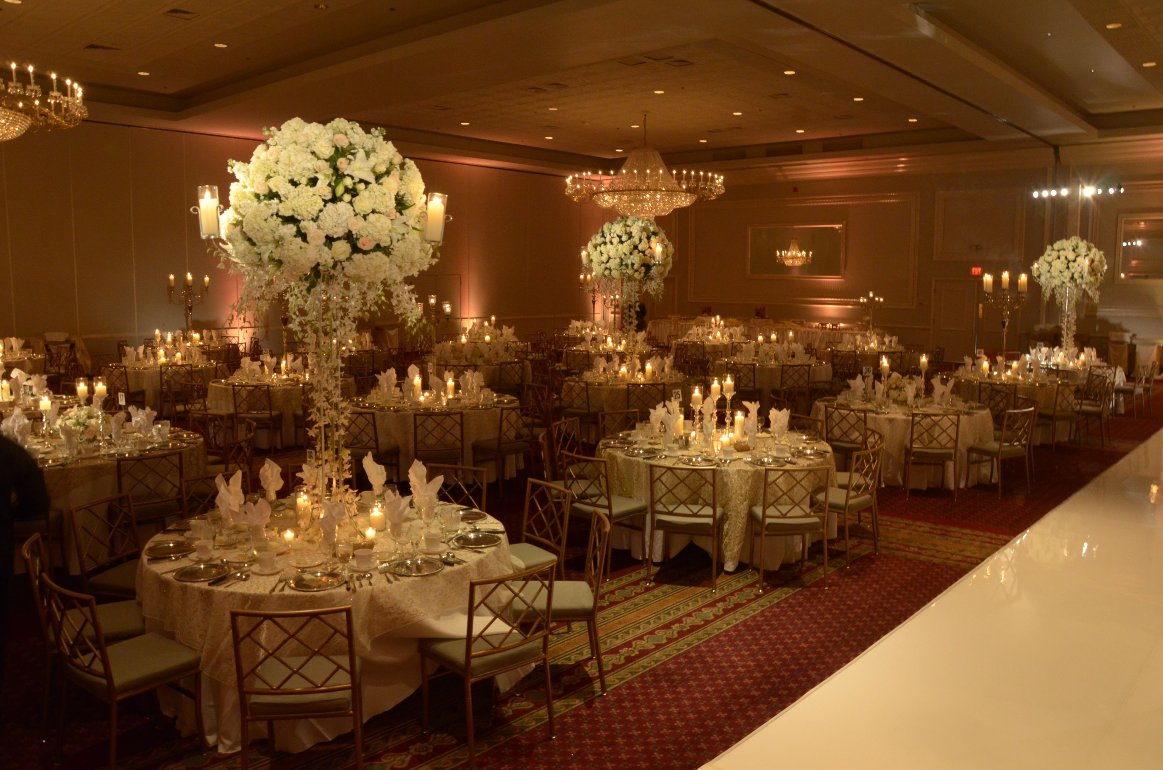 Large white rose centerpiece with pillar candles. #wedding ...
