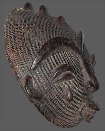 Ashanti mask (Ghana)  circa 1950/70 -   Art style by Doors Lifestyle. Visit www.doorslifestyle.com and subscribe for insider's hidden style treasures