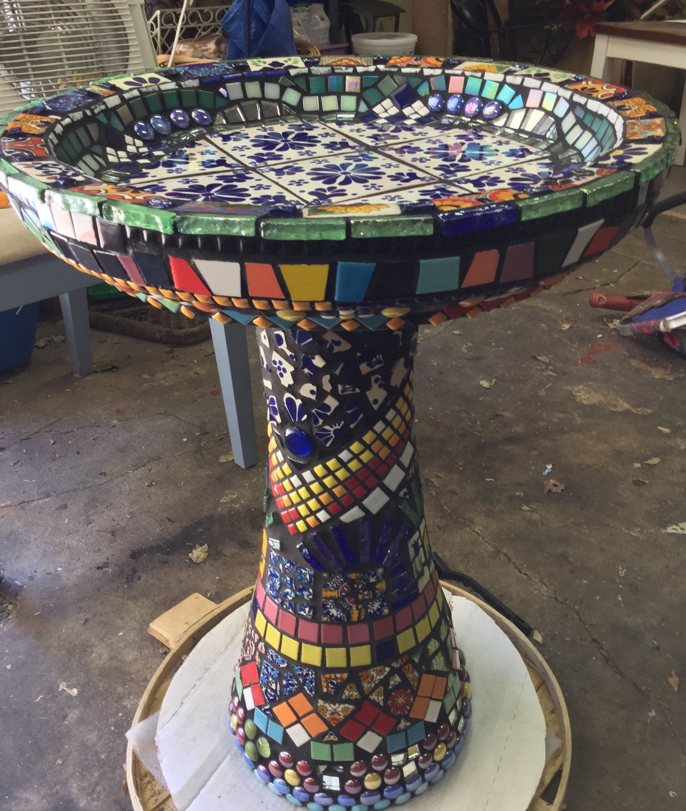 Mosaic art outdoor mosaic mosaic birdbath talavera tile mexican mosaic birdbath with talavera mexican and ceramic tile finished with black grout my first attempt at mosaic art was given an old cement birdbath that i dailygadgetfo Gallery
