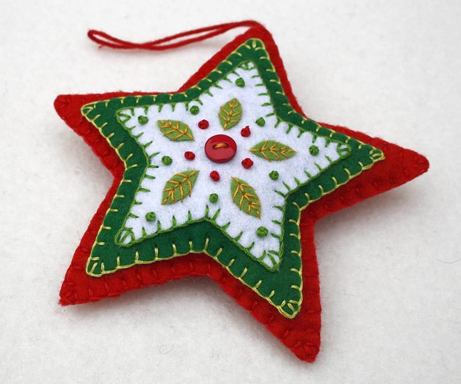 Red and green felt star Christmas ornament. Handmade felt hanging star with embroidered leaves and berries in green white and red, and a red button. A perfect gift or decoration . 4.25 inches / 11cm h