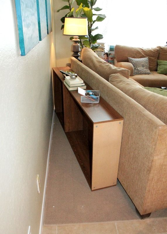 Upcycle a bookcase into a behind the couch table then just push
