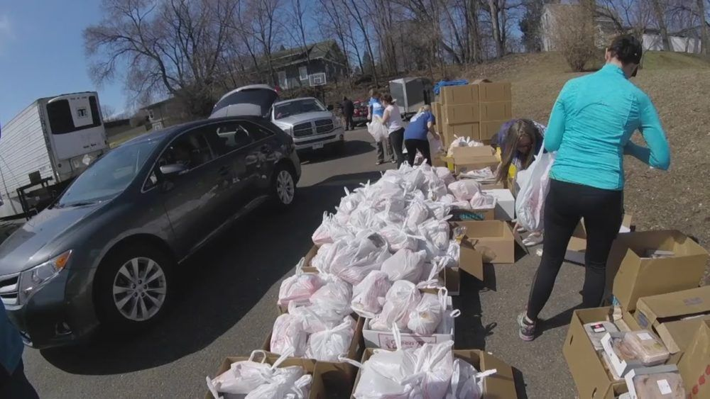 Thousands Of Cars Lined Up To Receive Food Donations From
