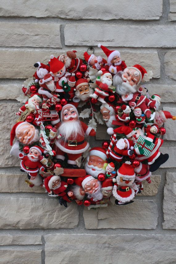 Vintage Christmas Santa Wreath Hand Crafted Hand Made Heirloom Wreath Vintage Santa Collectable OOAK. Santa, St. Nick, Santa Claus, Kris Kringle, Papa Noel, St. Nicholas, Father Christmas...they are all here in one wreath!!! Santa overload with big Santas, little Santas, soft Santas, flocked Santas and more!!! No room for more! Accented with red glass ornaments. Most all Santas are vintage and collectable on their own. Wreath measures 20 diameter and finished on back so you can hand it on a…