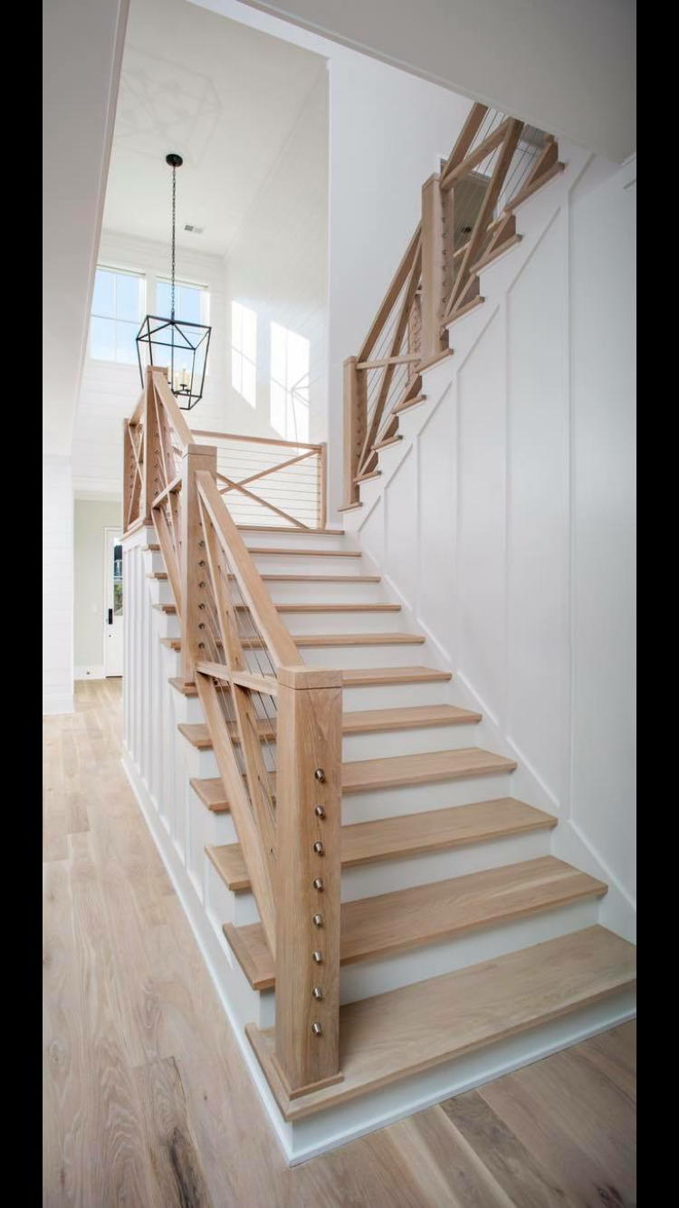 Best Naturally Sanded Wood Staircase Amidst Painted White Walls 400 x 300
