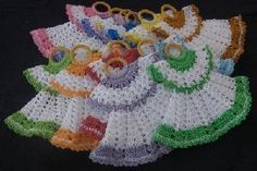 Step by step pictures on ow to make dress potholder. The diagram, I had already pinned. #crochetpotholderpatterns
