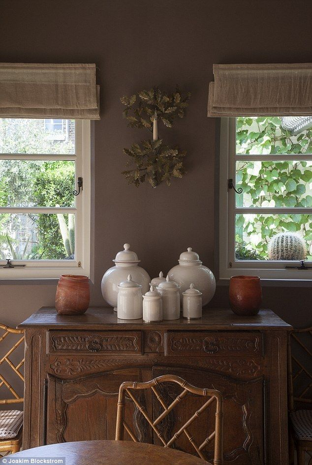 Neisha inherited the sideboard in the dining room from her mother Felicity (the late Roald Dahl's second wife). The 50s chinoiserie bamboo chairs were found at Battersea's Decorative Antiques & Textiles Fair. For similar chairs, try 1stdibs.com. The collection of white ceramics was bought in Mustapha Blaoui in the Marrakech medina – 'an Aladdin's cave of lamps and textiles', says Neisha. Re sells a similar metal wall sconce(re-foundobjects.com)