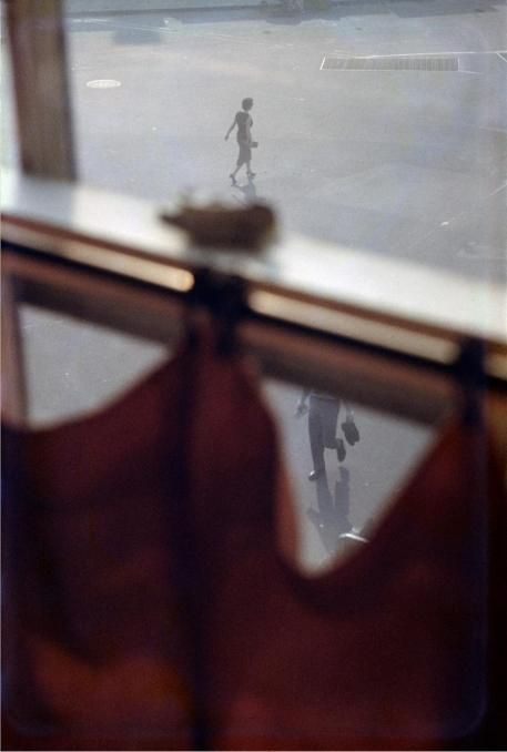 Photo by Saul Leiter, 1956,  Red Curtain.