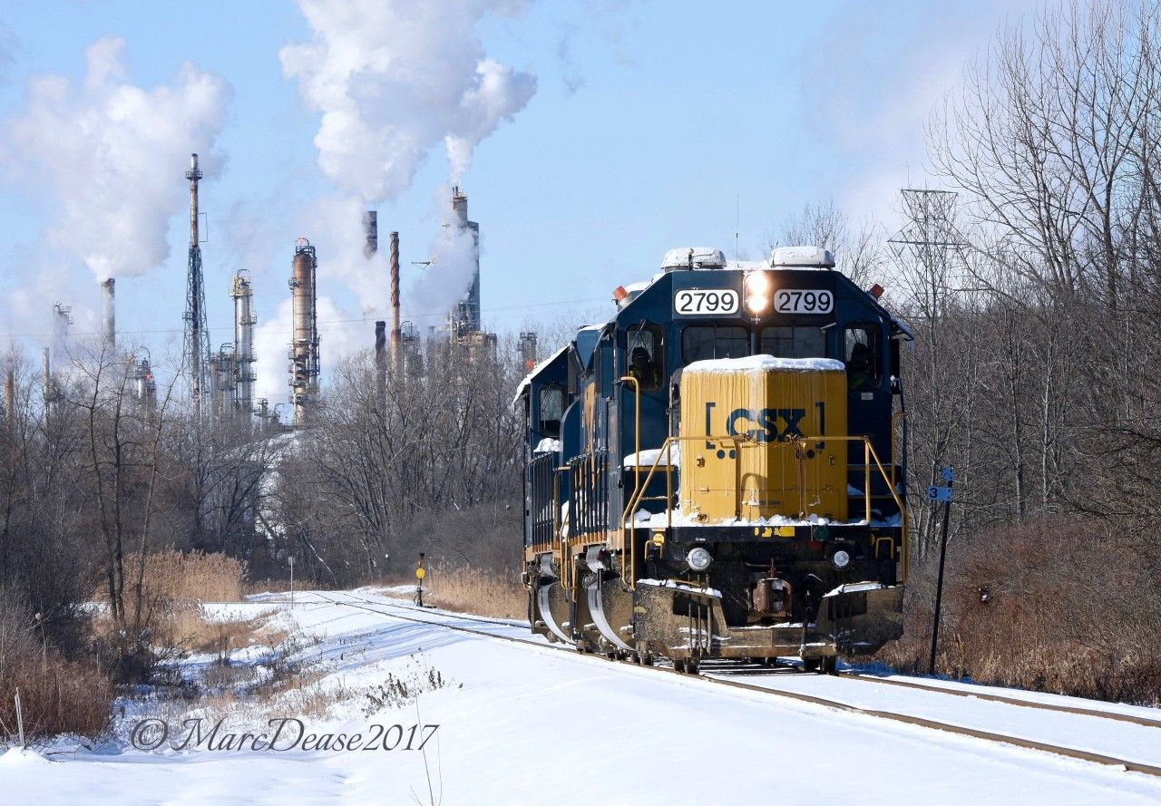The daily CSX Industrial on its way to the CN Yard light power with a nice layer of fresh snow and the steam plumes from Suncor's Sarnia Refinery.