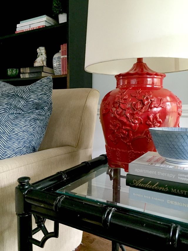 spray painting a chinoiserie lamp in  Rust-Oleum Gloss Apple Red