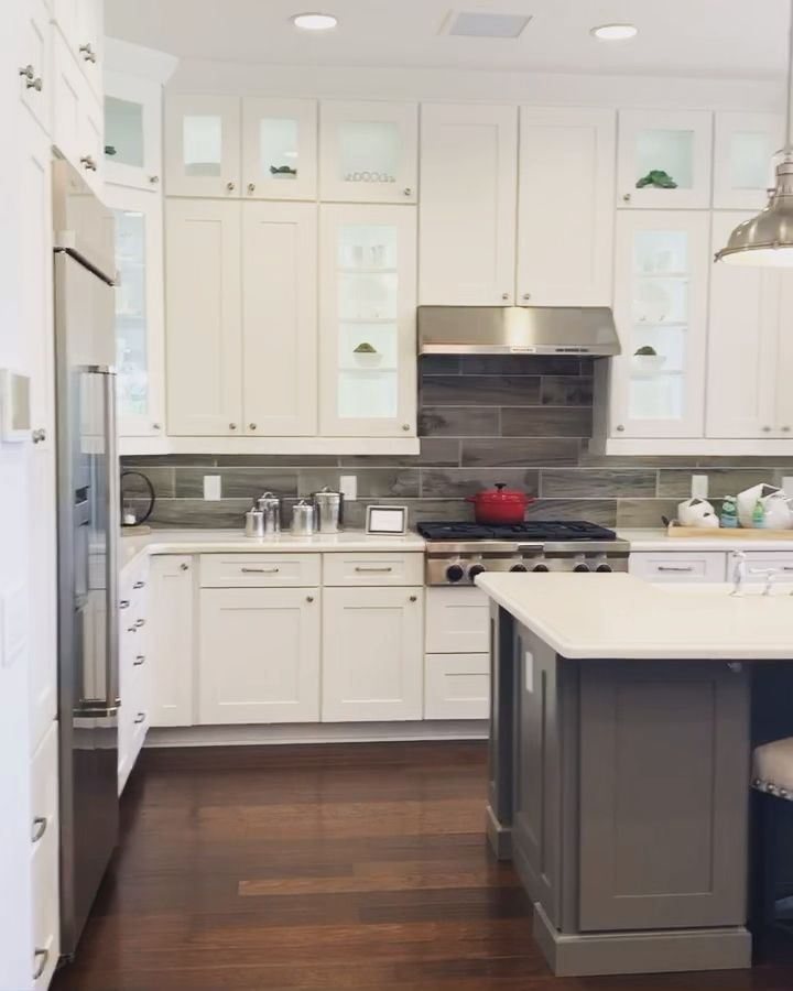 New home model by Toll Brothers includes white kitchen cabinets, quartz countertops, open concept living and hard wood flooring. #floridaliving #HomeInteriors #WhiteKitchens