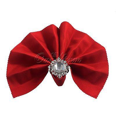 Red napkin in a bow with pearl napkin ring