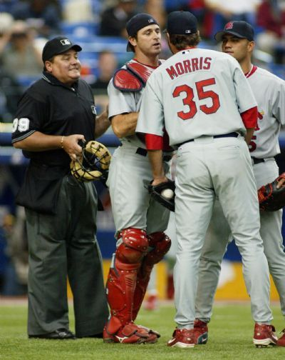 Matt Morris is held back by catcher Mike Matheny as he argues with the home plate umpire. May 7, 2004
