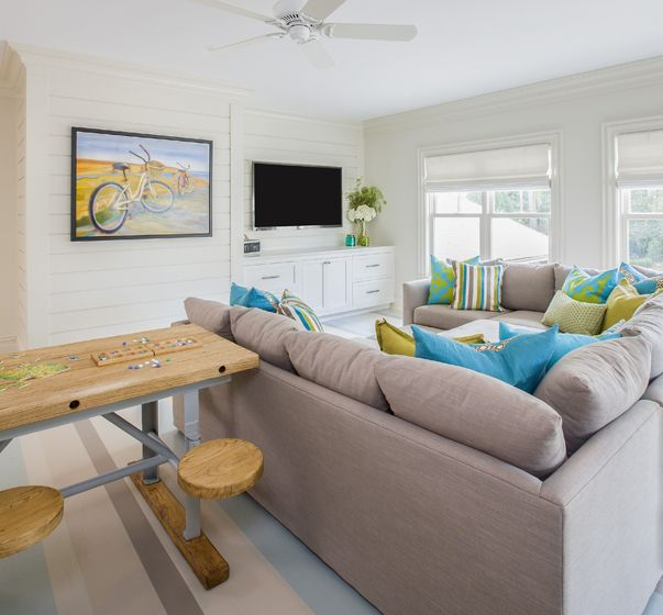 """I call this the """"kid pit"""". Literally this sectional creates a square design so sleepovers and move watching, or gaming become a big huge comfy area to lounge for all the kids. I had SwatchRoom paint the floor in different hues to act as a rug."""